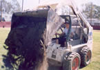 tractor hauling top dressing
