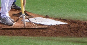 placing the tamp mat over the mound clay