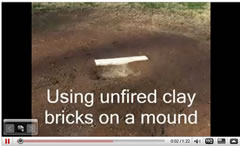 installing clay bricks on the mound