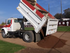 Dumping a 3 yard pile of baseball dirt near first base
