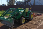 tractor with front loader and rear tiller