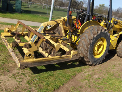 spike drag attachment on a tractor