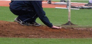 spreading mound clay in the holes