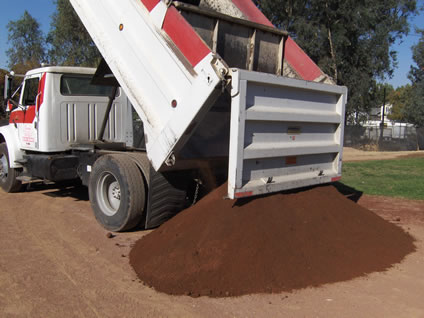 truck dumping baseball dirt on the infield